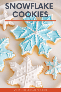 Snowflake cookies decorated with blue and white icing make a sweet holiday display. These simple cut out cookies are decorated with royal icing and will wow at your cookie exchange!