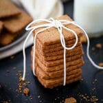 A stack of Homemade Graham Crackers tied up with a white string.