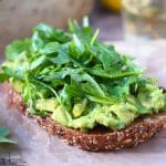 Close up shot of Lemony Avocado Toast with Arugula