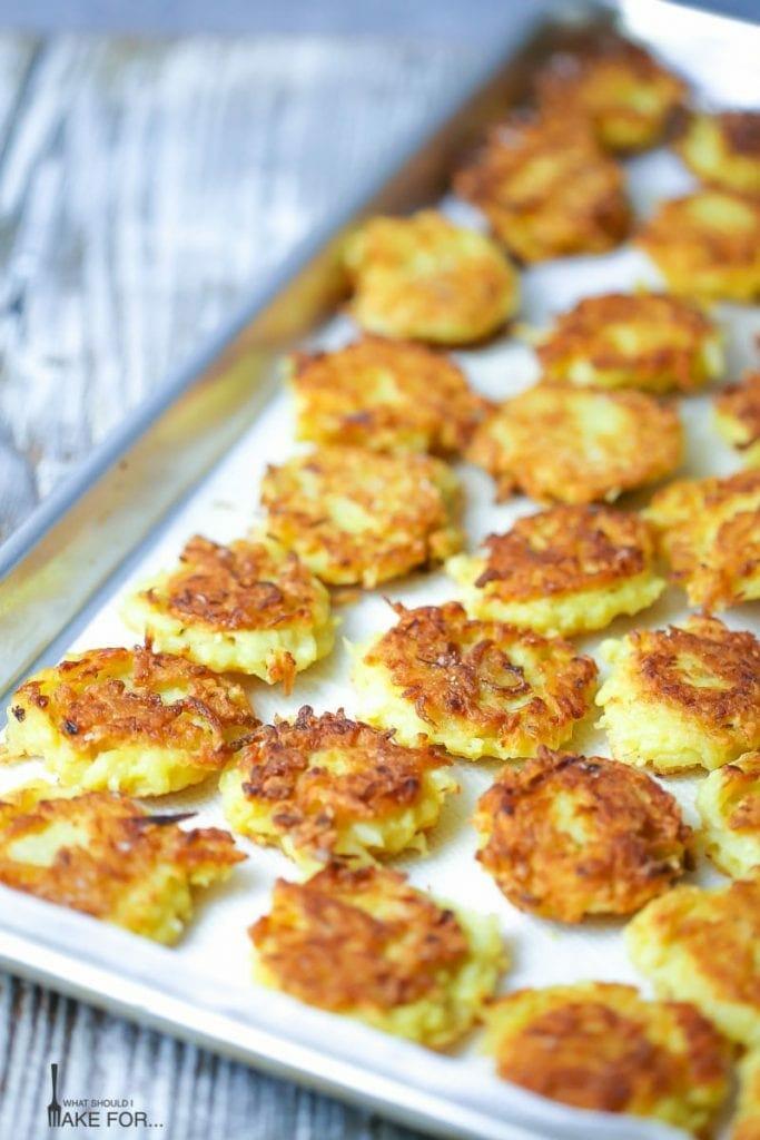 Mini Potato Latkes fresh out of the oven on a baking sheet.
