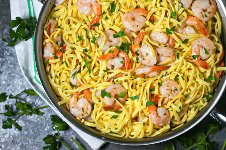 Close up of a pan of easy shrimp scampi sprinkled with parsley.