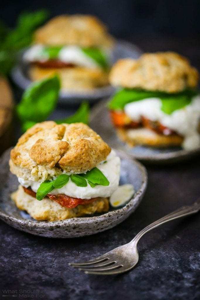 """Tomato """"Shortcake"""" with Whipped Ricotta served on small ceramic plates."""