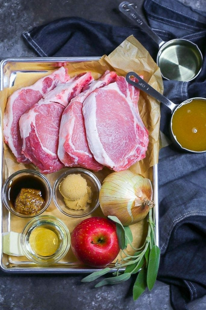Ingredients are gathered on a tray to make apple cider pork chops.