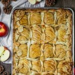Overhead shot of Caramel Apple Slab Pie baked on a half sheet tray decorated with pastry leaves and twists.