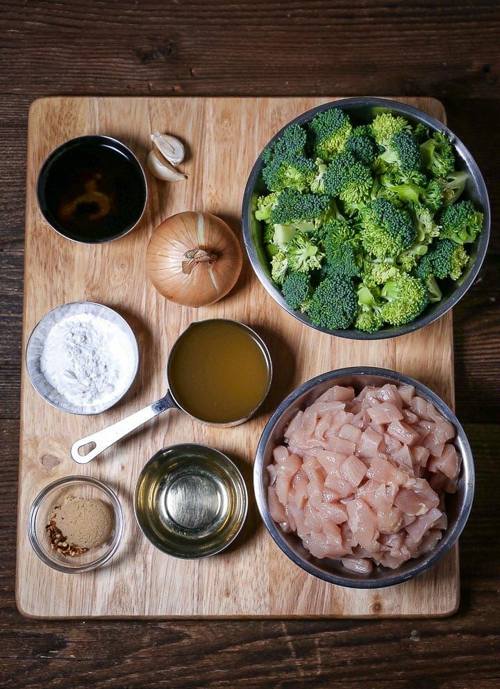 All the ingredients for Chicken and Broccoli Stir-Fry arranged on a cutting board.