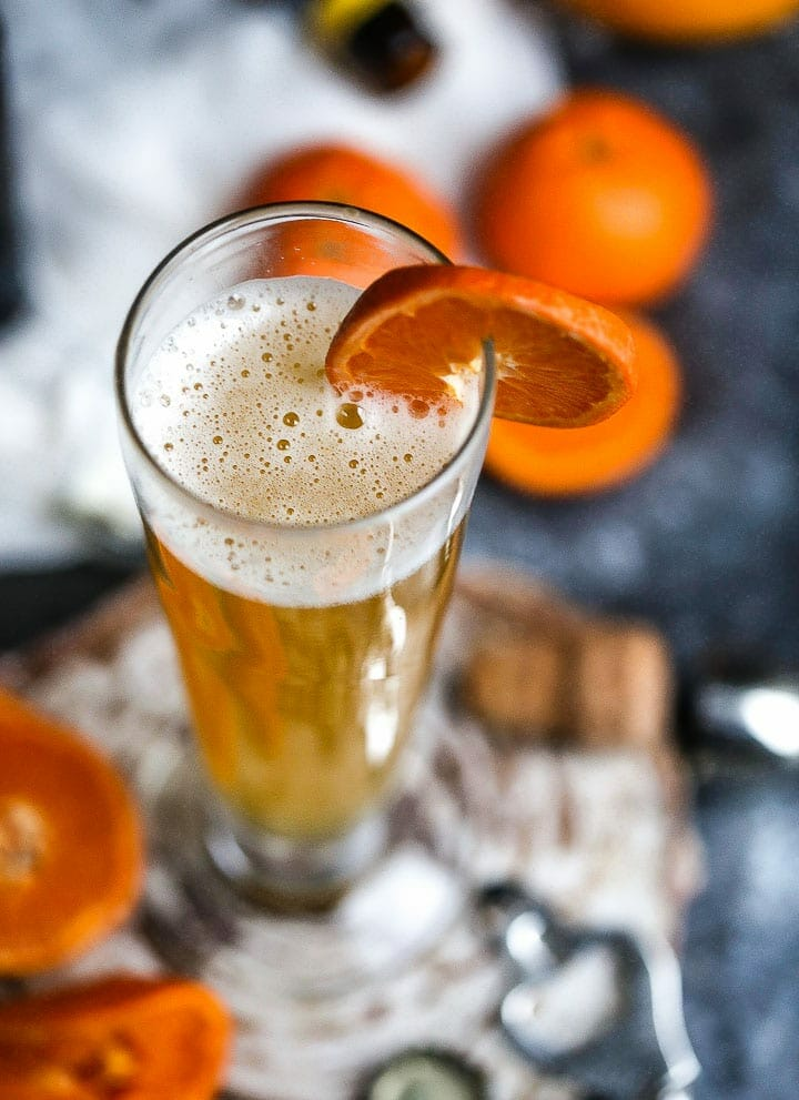 The Mustache (aka the Manly Mimosa) is garnished with an orange slice and shot form overhead.