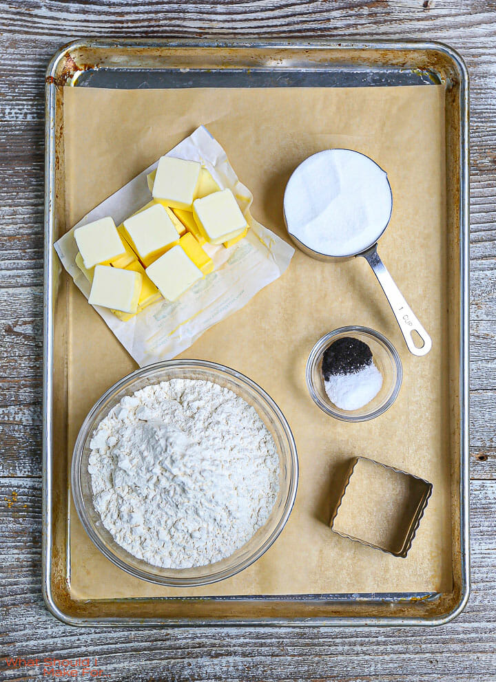 The ingredients for Classic Shortbread Cookies on a sheet tray.