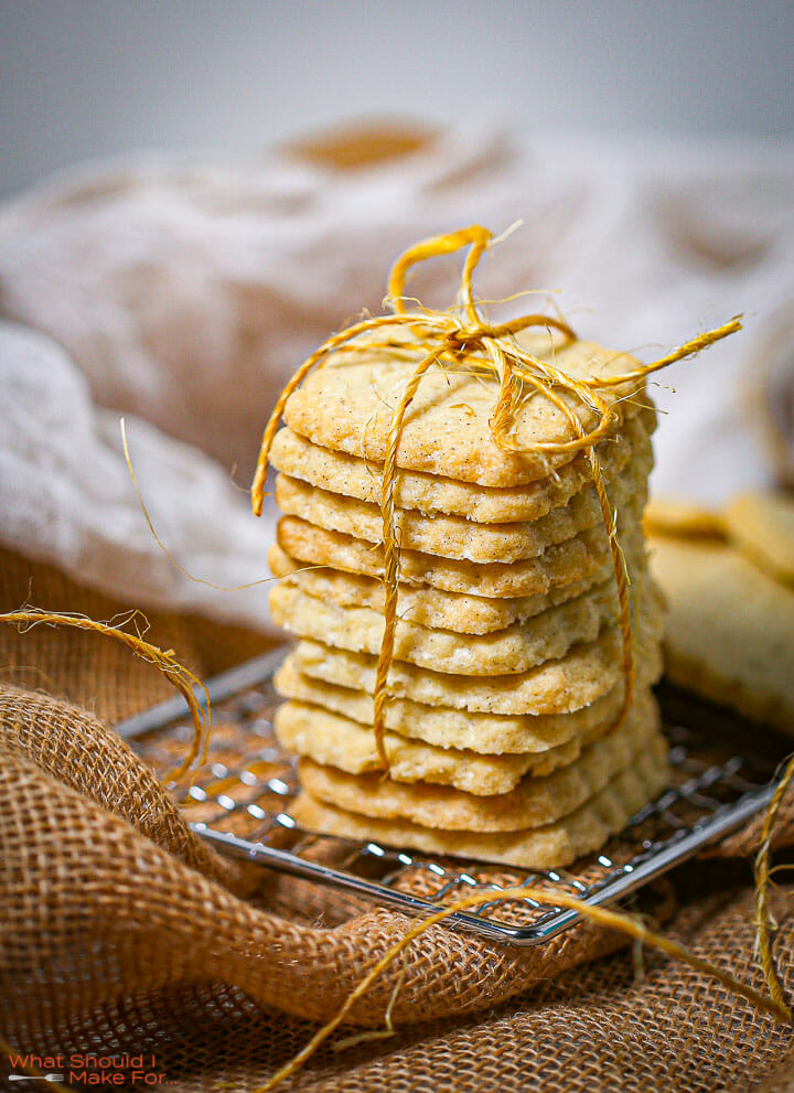 A stack of classic shortbread cookies on a wire rack tied with twine.