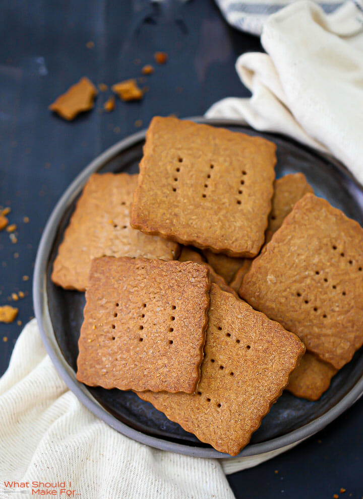 A plate of Homemade Graham Crackers on a round black plate.