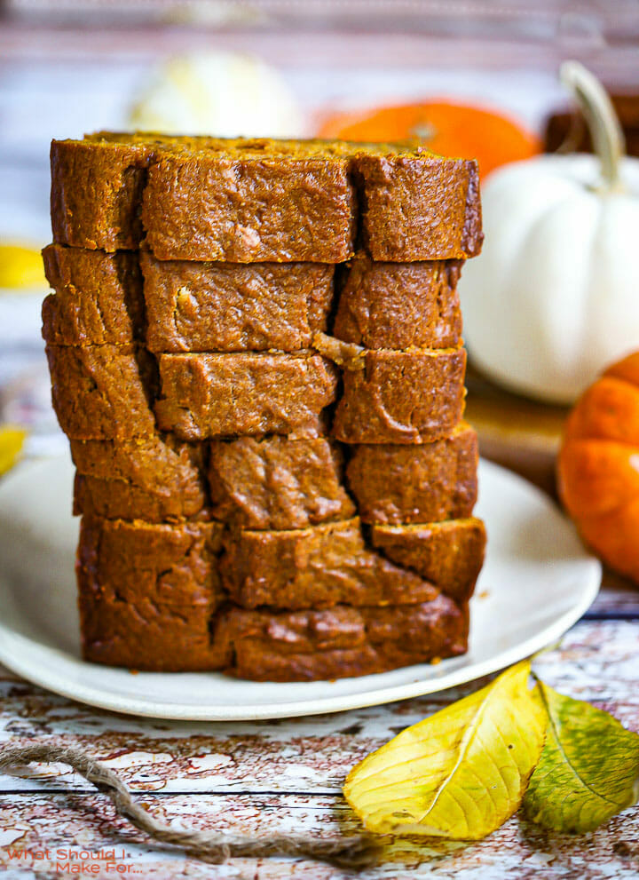A stack iof sliced pumpkin bread on a plate.