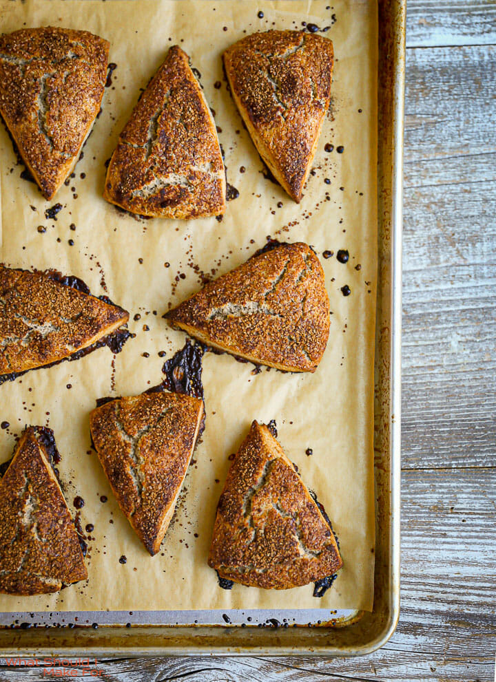 Cinnamon Sugar Scones on a parchment lined baking sheet.