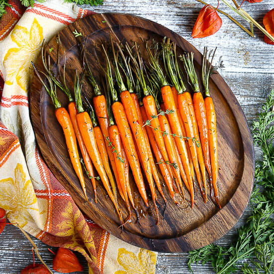 Honey Glazed Carrots on a wooden serving tray.