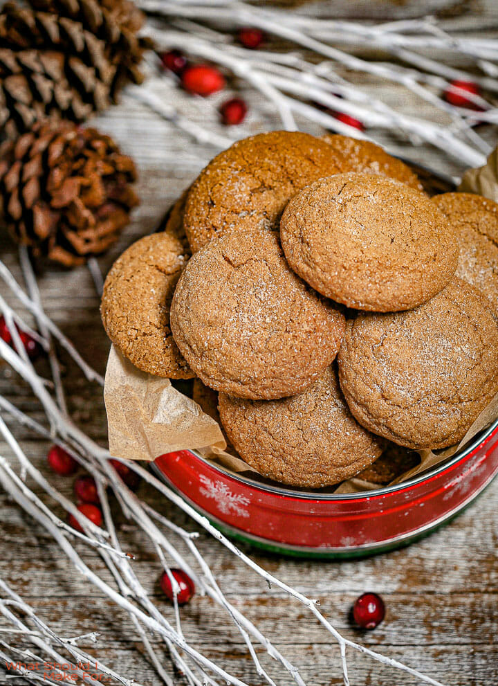 Soft Molasses Cookies in a red tin with white branches around.