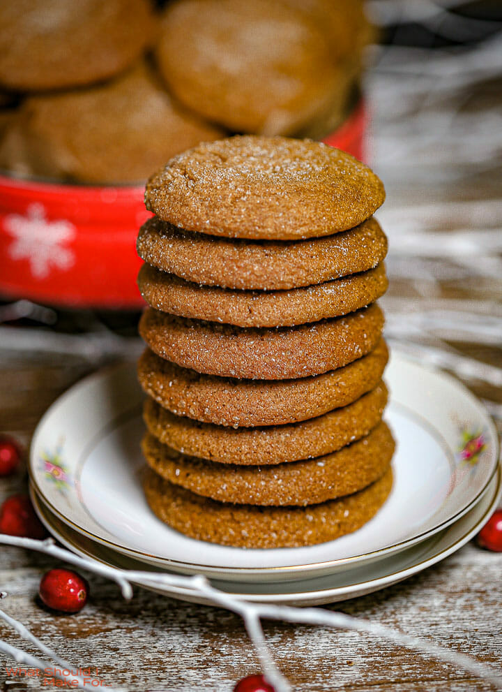 A stack of Soft Molasses Cookies on a small flowered plate.