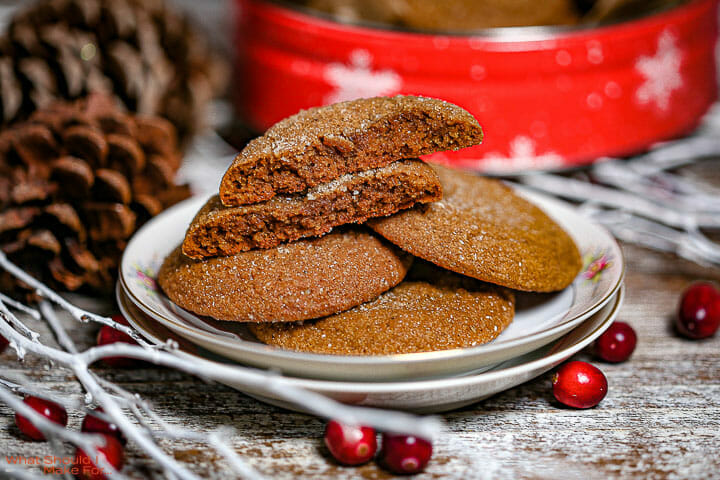 Soft Molasses Cookies on a plate with one cookie broken in half.