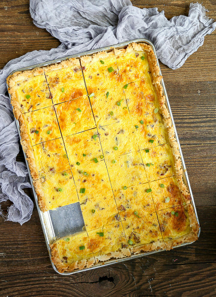 Sheet Pan Quiche Lorraine with one square removed.