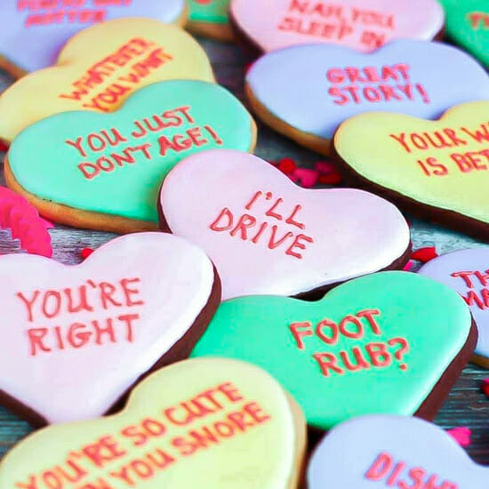 A close up of Conversation Heart Cookies inscribed with funny messages.