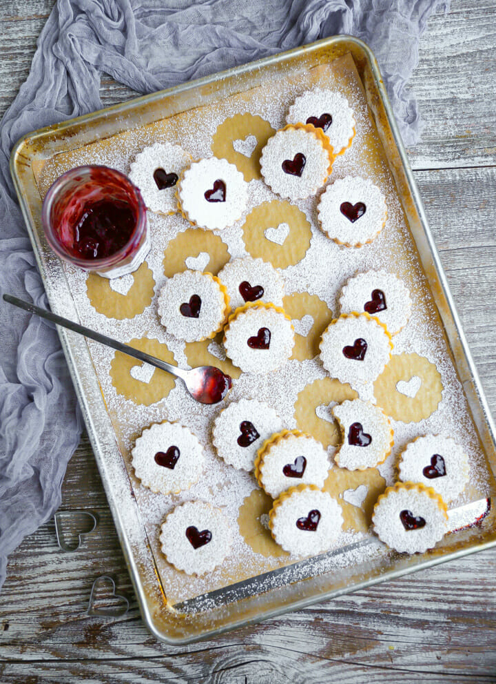 Nut-free linzer cookies filled with jam and generously dusted with powdered sugar.