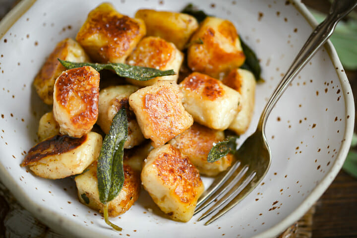 A close up of a serving of Pan Seared Gnocchi in Brown Butter Sage Sauce.