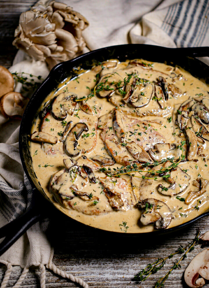 Loads of mushrooms in the creamy sauce with pork chops.